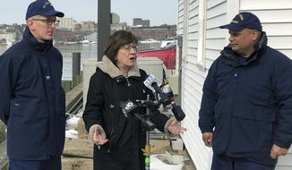U.S. Sen. Susan Collins, R-Maine, is flanked by Coast Guard Capt. Brian LeFebvre, left, and Rear Adm. Andrew Tiongson, right, as she addresses reporters after the ribbon-cutting at a U.S. Coast Guard regional command center Wednesday, Feb. 20, 2019, in South Portland, Maine. Collins said that she would vote for a congressional resolution disapproving of President Donald Trump's emergency declaration to build a wall on the southern border. She is the first Republican senator to publicly express support for such a resolution. (AP Photo/David Sharp)