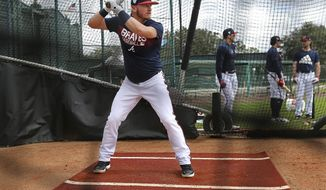 Atlanta Braves newly acquired third baseman Josh Donaldson takes some batting practice  during spring training baseball practice, Wednesday, Feb. 20, 2019, in Kissimmee, Fla. (Curtis Compton/Atlanta Journal-Constitution via AP)