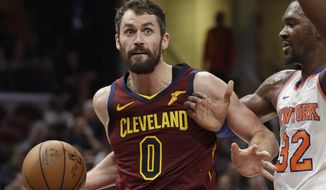 FILE - In this Feb. 11, 2019, file photo, Cleveland Cavaliers' Kevin Love (0) drives past New York Knicks' Noah Vonleh (32) in the first half of an NBA basketball game, in Cleveland. Love relaxed on the beach under the warm Caribbean sun during the All-Star break. He's hoping it keeps shining on him and the Cavaliers in the second half of a depressing, gloomy season.(AP Photo/Tony Dejak, File)