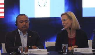 U.S. Secretary of Homeland Security Kirstjen Nielsen, right, talks to El Salvador Minister of Justice and Public Security Mauricio Ramirez Landaverde at the start of a meeting on migration and security issues between Nielsen and government ministers from Honduras, Guatemala, and El Salvador, in San Salvador, El Salvador, Wednesday, Feb. 20, 2019. (AP Photo/Salvador Melendez)