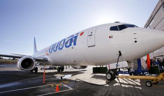 FILE - This Oct. 27, 2010, file photo shows a Boeing 737 being delivered to FlyDubai in Seattle. Budget carrier FlyDubai said Wednesday, Feb. 20, 2019, that revenues rose to $1.7 billion in 2018, but the company ended the year with a loss of $43.5 million. (AP Photo/Elaine Thompson, File)