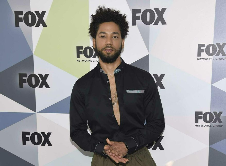 """FILE - In this May 14, 2018 file photo, Jussie Smollett, a cast member in the TV series """"Empire,"""" attends the Fox Networks Group 2018 programming presentation afterparty in New York. A police official says """"Empire"""" actor is now considered a suspect """"for filing a false police report"""" and that detectives are presenting the case against him to a grand jury. Smollett told police he was attacked by two masked men while walking home from a Subway sandwich shop at around 2 a.m. on Jan. 29. He says they beat him, hurled racist and homophobic insults at him and looped a rope around his neck before fleeing. (Photo by Evan Agostini/Invision/AP, File)"""