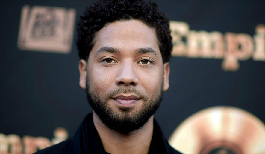 """FILE - In this May 20, 2016 file photo, actor and singer Jussie Smollett attends the """"Empire"""" FYC Event in Los Angeles. A police official says """"Empire"""" actor is now considered a suspect """"for filing a false police report"""" and that detectives are presenting the case against him to a grand jury. Smollett told police he was attacked by two masked men while walking home from a Subway sandwich shop at around 2 a.m. on Jan. 29. He says they beat him, hurled racist and homophobic insults at him and looped a rope around his neck before fleeing. (Richard Shotwell/Invision/AP, File)"""