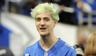"""This Sept. 10, 2018, file photo shows Tyler """"Ninja"""" Blevins before an NFL football game between the Detroit Lions and New York Jets in Detroit. For the first time since its meteoric rise, """"Fortnite"""" is no longer a no-doubt victory royale atop the video game industry. """"Apex Legends,"""" a battle royale from Electronic Arts, has stormed the market and smashed """"Fortnite"""" records for downloads and viewership since its release three weeks ago. (AP Photo/Jose Juarez, File)"""