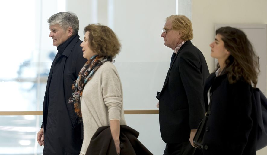 Former CEO of Global Wealth Management and Business Banking at UBS AG Raoul Weil, left, his wife, 2nd left, former General Director of UBS France Patrick de Fayet, 2nd right, and one member of their legal team arrive for the the Swiss bank's trial at the Paris courthouse in Paris, France, Wednesday, Feb. 20, 2019. A Paris court has ordered Swiss bank UBS to pay 3.7 billion euros ($4.2 billion) in fines for helping wealthy French clients evade tax authorities. (AP Photo/Michel Euler)