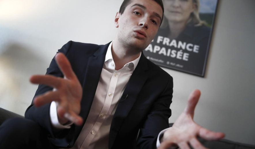 Head of Marine Le Pen's party list for the European Parliament elections, Jordan Bardella speaks during an interview with Associated Press in Nanterre, outside Paris, Wednesday, Feb. 20, 2019. (AP Photo/Christophe Ena)