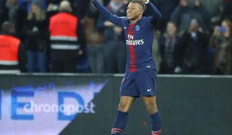 PSG's Kylian Mbappe celebrates after scoring his side's fifth goal during the French League One soccer match between Paris Saint Germain and Montpellier at the Parc des Princes stadium in Paris, France, Wednesday, Feb. 20, 2019. (AP Photo/Francois Mori)