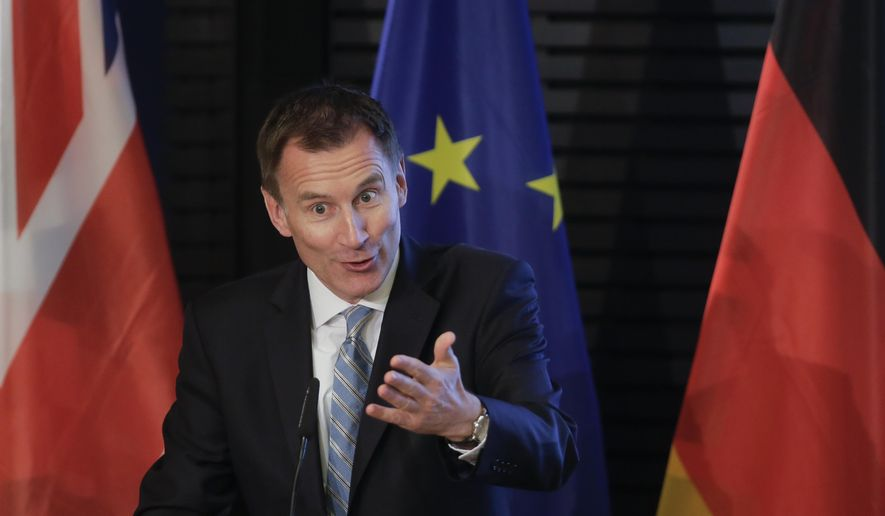 British Foreign Secretary Jeremy Hunt delivers a speech about Britain and Europe at the Konrad-Adenauer-Foundation in Berlin, Germany, Wednesday, Feb. 20, 2019. (AP Photo/Markus Schreiber)