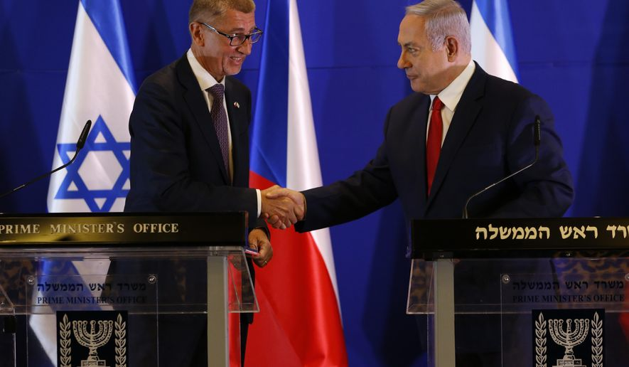 Czech Republic's Prime Minister Andrej Babis, left, Israeli Prime Minister Benjamin Netanyahu shake hands during a press conference after their meeting in Jerusalem, Tuesday, Feb. 19, 2019. (AP Photo/Ariel Schalit, Pool)