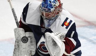 Colorado Avalanche goaltender Semyon Varlamov makes a glove save against the Winnipeg Jets in the first period of an NHL hockey game Wednesday, Feb. 20, 2019, in Denver. (AP Photo/David Zalubowski)