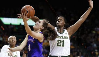 Kansas forward Mariane de Carvalho (4) goes up for a shot that was blocked by Baylor's Kalani Brown (21) during the first half of an NCAA college basketball game in Waco, Texas, Wednesday, Feb. 20, 2019. (AP Photo/Tony Gutierrez)