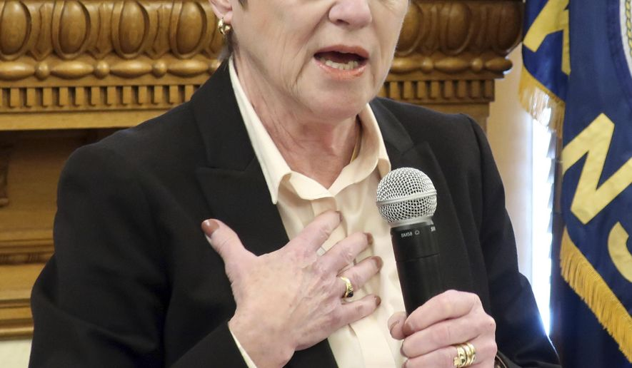 FILE - In this Jan. 24, 2019 file photo, Kansas Gov. Laura Kelly answers questions from reporters during a news conference at the Statehouse in Topeka, Kan. Kelly's election created a national buzz about a possible shift to the left in Kansas politics, but many Republicans remain unimpressed and feel little pressure to take up her big initiatives. The GOP-dominated Legislature has yet to have committee hearings on her plan to expand the state's Medicaid health coverage for the needy. It has ignored her call to approve an increase in public school funding by the end of this month. A key part of her budget already appears dead. Top Republicans are pursuing a tax relief bill she considers fiscally reckless. (AP Photo/John Hanna, File)