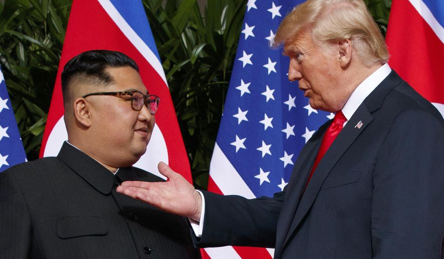 In this June 12, 2018, file photo, U.S. President Donald Trump, right, meets with North Korean leader Kim Jong-un on Sentosa Island in Singapore. With their second summit fast approaching, speculation is growing that Trump may try to persuade Kim to commit to denuclearization by giving him something he wants more than almost anything else, an announcement of peace and an end to the Korean War. (AP Photo/Evan Vucci, File)