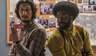 """This image released by Focus Features shows Adam Driver, left, and John David Washington in a scene from """"BlacKkKlansman."""" The film is nominated for an Oscar for best picture. The 91st Academy Awards will be held on Sunday. (David Lee/Focus Features via AP)"""
