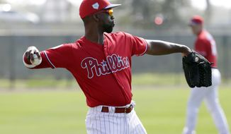 Philadelphia Phillies' Andrew McCutchen does drills at the Phillies spring training baseball facility, Tuesday, Feb. 19, 2019, in Clearwater, Fla. (AP Photo/Lynne Sladky)