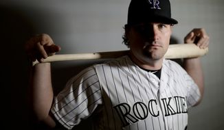 Colorado Rockies second baseman Daniel Murphy poses for a picture at their spring baseball training facility in Scottsdale, Ariz., Wednesday, Feb. 20, 2019. Accustomed to the postseason, Daniel Murphy focused his free agent checklist on playoff contenders. When the ascendant Rockies showed as much interest in Murphy as he had in them, working out the details of a two-year, $24 million contract was no big deal. (AP Photo/Chris Carlson, File)
