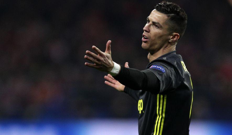 Juventus forward Cristiano Ronaldo reacts during the Champions League round of 16 first leg soccer match between Atletico Madrid and Juventus at Wanda Metropolitano stadium in Madrid, Wednesday, Feb. 20, 2019. (AP Photo/Manu Fernandez)