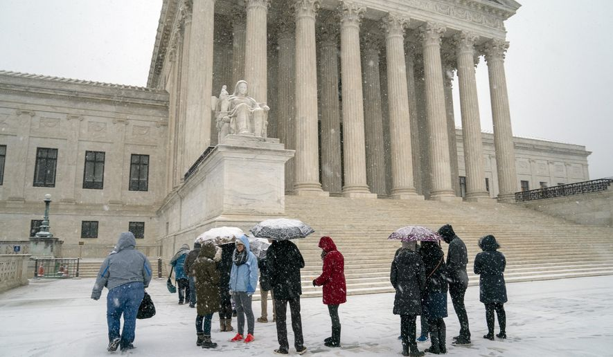 Visitors wait to enter the Supreme Court as a winter snowstorm hits the nation's capital making roads perilous and closing most federal offices and all major public school districts, on Capitol Hill in Washington, Wednesday, Feb. 20, 2019. The Supreme Court is ruling unanimously that the Constitution's ban on excessive fines applies to the states. The outcome Wednesday could help an Indiana man recover the $40,000 Land Rover police seized when they arrested him for selling about $400 worth of heroin. (AP Photo/J. Scott Applewhite)