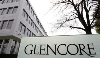 FILE - This April 14, 2011 file picture shows the Glencore headquarters in Baar, Switzerland. Commodities giant Glencore says it will cap how much coal it mines amid shareholder pressure to reduce emissions of greenhouse gases. (AP Photo/Keystone, Urs Flueeler, file)