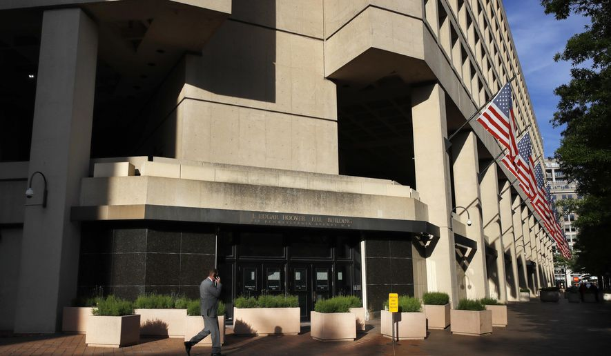 FILE - In this May 9, 2017, file photo, the J. Edgar Hoover FBI building on Pennsylvania Avenue in Washington. The FBI developed a backup plan to protect evidence in its Russia investigation soon after the firing of FBI Director James Comey in the event that other senior officials were dismissed as well, according to a person with knowledge of the discussions. (AP Photo/Jacquelyn Martin, File)