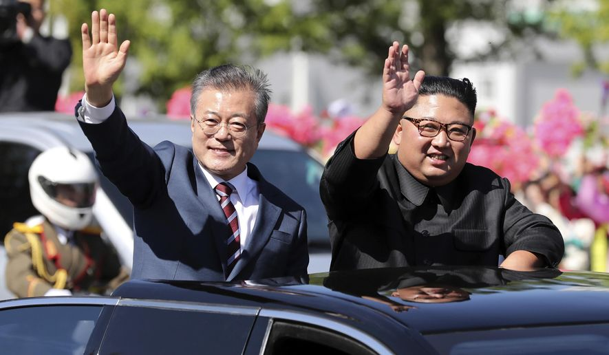FILE - In this Sept. 18, 2018, file photo, South Korean President Moon Jae-in, left, and North Korean leader Kim Jong-un ride in a car during a parade through a street in Pyongyang, North Korea. The upcoming Trump-Kim meeting will be a crucial moment for South Korean President Moon Jae-in, who is desperate for more room to continue his engagement with North Korea, which has been limited by tough U.S.-led sanctions against Pyongyang. (Pyongyang Press Corps Pool via AP, File)