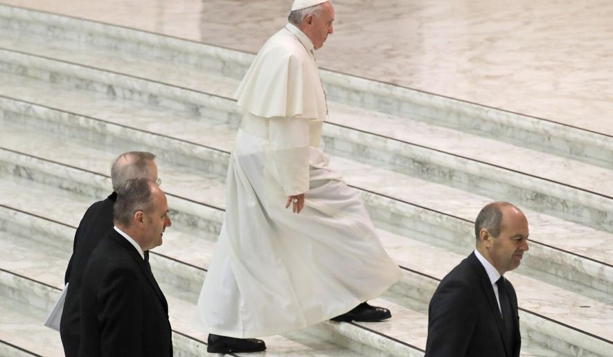 Pope Francis arrives in the Paul VI Hall at the Vatican for his weekly general audience, Wednesday, Feb. 20, 2019. (AP Photo/Alessandra Tarantino)