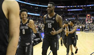 Georgetown guard Jahvon Blair (0), center Jessie Govan (15) and guard James Akinjo (3) react as they leave the court after an NCAA college basketball game against Villanova, Wednesday, Feb. 20, 2019, in Washington. Georgetown won 85-73. (AP Photo/Nick Wass) ** FILE **