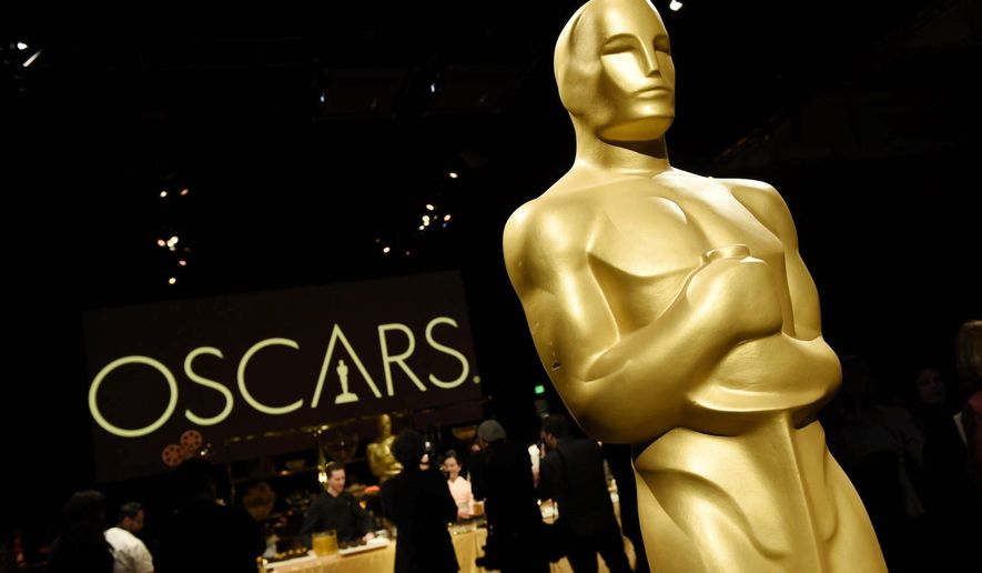 An Oscar is pictured at the press preview for the Academy Awards on Sunday. A poll says two-thirds of Americans may not be watching. (Associated Press)