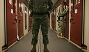 In this Oct. 9, 2007, file photo, reviewed by a U.S. Dept of Defense official, U.S. military personnel inspect each occupied cell on a two-minute cycle at Camp 5 maximum-security facility on the Guantanamo Bay U.S. Naval Base in Cuba. An effort to decrease the detainee population appears to have bogged down as authorities wrestle with what to do with those who cannot easily be brought to trial but are considered too dangerous to free, and others who have been cleared for release but can't be sent to their home countries. (AP Photo/Brennan Linsley, File)