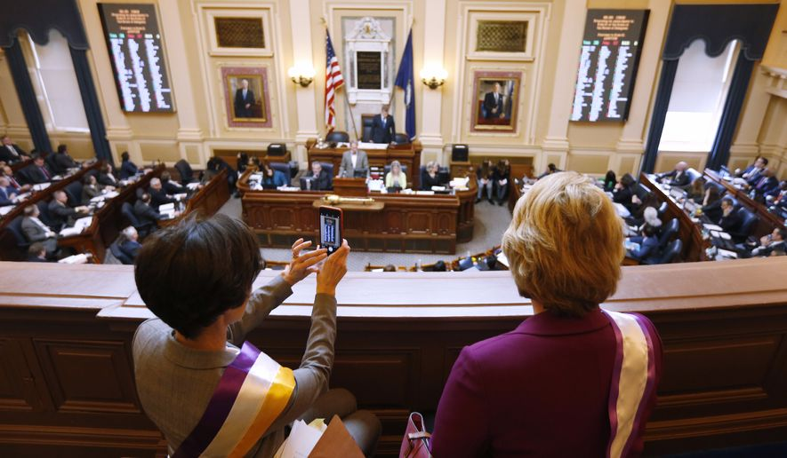 State Sens. Jennifer Boysko, D-Fairfax, left, and Janet Howell, D-Fairfax, watch a vote on a resolution that would bring the Equal Rights Amendment to the floor of the House at the Capitol in Richmond, Va., Thursday, Feb. 21, 2019. The resolution failed. (AP Photo/Steve Helber) ** FILE **