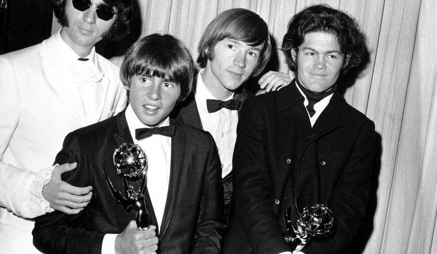 This June 4, 1967, file photo shows, from left, Mike Nesmith, Davy Jones, Peter Tork, and Micky Dolenz of The Monkees posing with their Emmy award for best comedy series at the 19th Annual Primetime Emmy Awards in Los Angeles.  Tork, who rocketed to teen idol fame in 1965 playing the lovably clueless bass guitarist in the made-for-television rock band The Monkees, died Thursday, Feb. 21, 2019, of complications related to cancer, according to his son Ivan Iannoli. He was 77.  (AP Photo, File)