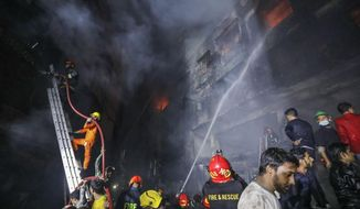 Firefighters work to douse flames in Dhaka, Bangladesh, Thursday, Feb. 21, 2019. A devastating fire raced through at least five buildings in an old part of Bangladesh's capital and killed scores of people. (AP Photo/Zabed Hasnain Chowdhury)
