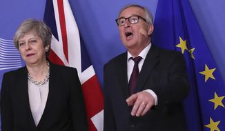 British Prime Minister Theresa May is greeted by European Commission President Jean-Claude Juncker prior to a meeting at EU headquarters in Brussels, Wednesday, Feb. 20, 2019. (AP Photo/Francisco Seco)