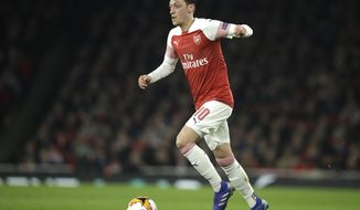 Arsenal's Mesut Ozil controls the ball during the Europa League round of 32 second leg soccer match between Arsenal and Bate at the Emirates stadium in London, Thursday, Feb. 21, 2019. (AP Photo/Matt Dunham)