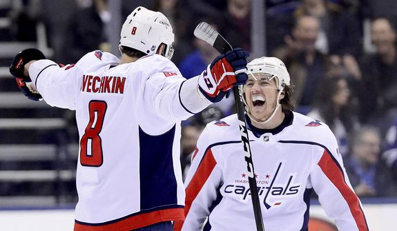 Washington Capitals left wing Alex Ovechkin (8) celebrates his goal with teammate T.J. Oshie (77) during second-period NHL hockey game action against the Toronto Maple Leafs in Toronto, Thursday, Feb. 21, 2019. (Frank Gunn/The Canadian Press via AP)