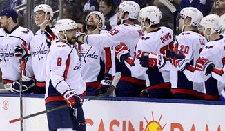 Washington Capitals left wing Alex Ovechkin (8) celebrates his goal with teammates on the bench during second-period NHL hockey game action against the Toronto Maple Leafs in Toronto, Thursday, Feb. 21, 2019. (Frank Gunn/The Canadian Press via AP)