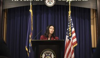Michigan Attorney General Dana Nessel announces that her office will investigate gymnastics coach John Geddert, Thursday, Feb. 21, 2019, during a press conference at the at the AG's office in Lansing, Mich. (Matthew Dae Smith/Lansing State Journal via AP)