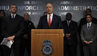 Joined by deputy special agent in charge of the DEA's Los Angeles division, William Bodner, left, U.S. Attorney Nick Hanna, center, speaks during a news conference Thursday, Feb. 21, 2019, in Los Angeles. An opioid crackdown in the Los Angeles area has led to the arrest of four doctors and other medical professionals, including one physician whose patient died of an overdose. (AP Photo/Jae C. Hong)