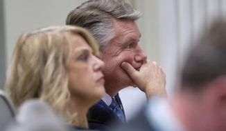Mark Harris, Republican candidate in North Carolina's 9th Congressional race, listens to testimony during the third day of a public evidentiary hearing on the 9th Congressional District voting irregularities investigation Wednesday, Feb. 20, 2019, at the North Carolina State Bar in Raleigh, N.C.  (Travis Long/The News & Observer via AP, Pool)