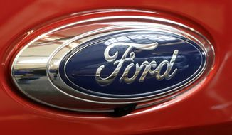 FILE- In this Feb. 14, 2019, file photo this is the Ford logo on a 2019 Ford Ranger 2019 Supercrew 4x4 on display at the 2019 Pittsburgh International Auto Show in Pittsburgh. Ford says it has launched an investigation into whether a flawed mathematical model caused it to overstate gas mileage and understate pollution from a wide range of vehicles. The company says a group of employees reported possible problems with the model in September. So it has hired an outside firm to test the 2019 Ford Ranger. (AP Photo/Gene J. Puskar, File)
