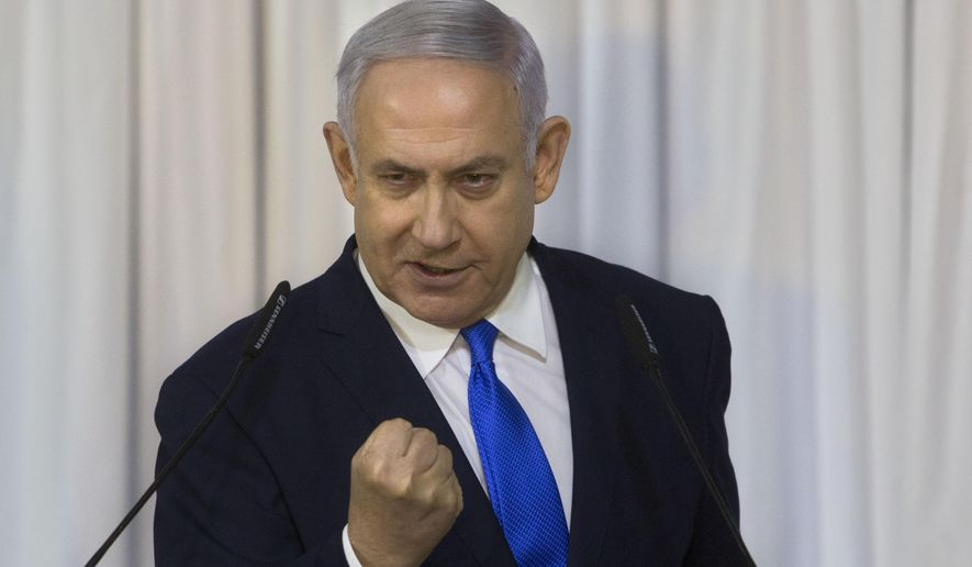 Israeli Prime Minister Benjamin Netanyahu gestures as he delivers a statement in Ramat Gan, Israel, Thursday, Feb. 21, 2019. (AP Photo/Sebastian Scheiner)