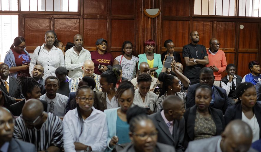 FILE-- In this file photo of Thursday Feb.22, 2018. Members of the public fill the courtroom as the High Court in Kenya begins hearing arguments in a case challenging parts of the penal code seen as targeting the lesbian, gay, bisexual and transgender communities, at the High Court in Nairobi, Kenya. Extortion, human rights violations ranging from assaults, physical, sexual and verbal, denial of access to state services, forceful evictions, harassment, being disowned by family members among other challenges, may become a thing of the past for the Kenyan gay community if a court rules on Friday Feb. 22, 2019, in their favour to abolish laws that criminalize homosexual behaviour.(AP Photo/Ben Curtis-File)