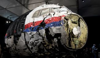 This Tuesday, Oct. 13, 2015, file photo, shows the reconstructed wreckage of Malaysia Airlines Flight MH17, put on display during a press conference in Gilze-Rijen, central Netherlands. Malaysia Airlines Flight 17 broke up high over Eastern Ukraine killing all 298 people on board. A Dutch safety watchdog says airlines around the world need more and better information to make risk assessments about flying over conflict zones. The Dutch Safety Board issued a report Thursday, Feb. 21, 2019, following up on its publication in 2015 of a probe into the cause of the downing of Malaysia Airlines Flight 17 over war-ravaged eastern Ukraine on July 17, 2014. (AP Photo/Peter Dejong, File)