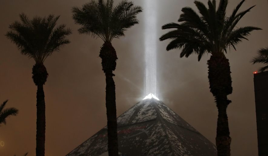 Snow falls on the Luxor hotel and casino Wednesday, Feb. 20, 2019, in Las Vegas. A winter storm is expected to drop up to 3 inches (8 centimeters) of snow on Las Vegas' southern and western outskirts while other parts of the metro area will get rain mixed with snow. (AP Photo/John Locher)