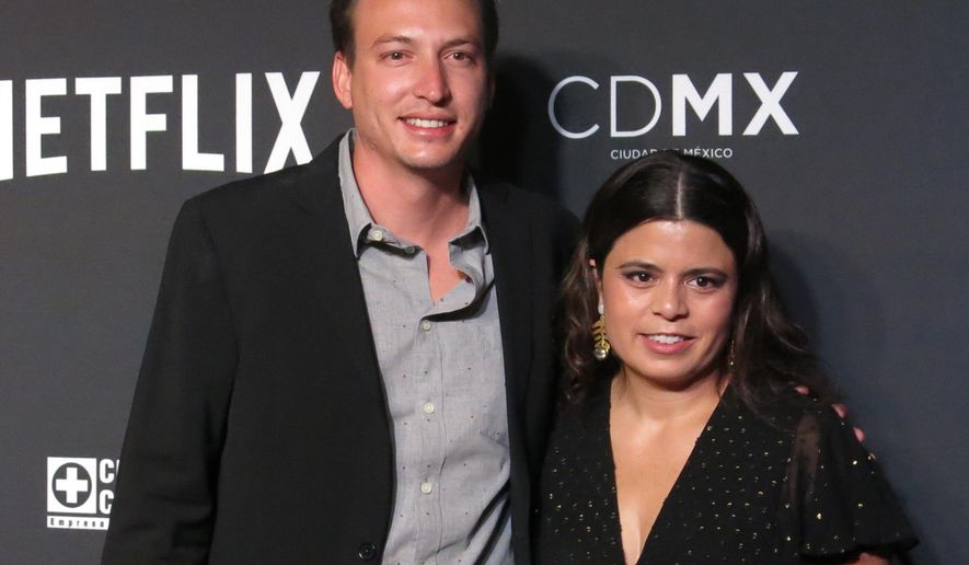 """FILE - In this Nov. 21, 2018 file photo, Roma film producers Nicolas Celis, of Mexico, and Gabriela Rodriguez, of Venezuela, pose on the red carpet, in Mexico City. As the producer of """"Roma,"""" Rodriguez is the first Latino woman nominated to the Oscars for best picture. The Academy Awards are Sunday, Feb. 24 (AP Photo/Berenice Bautista, File)"""