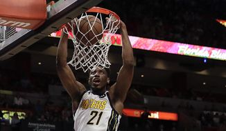 FILE - In this Feb. 2, 2019, file photo, Indiana Pacers forward Thaddeus Young dunks against the Miami Heat in the first half of an NBA basketball game, in Miami. When All-Star guard Victor Oladipo crashed to the floor in late January, the silence inside Bankers Life Fieldhouse was deafening. Starting forwards Thaddeus Young, a co-captain, and Bojan Bogdanovic reasserted themselves as leaders _ just like when the Pacers went 7-4 without Oladipo in November and December. (AP Photo/Brynn Anderson, File)