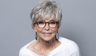 """FILE - This July 29, 2018 file photo shows actress Rita Moreno, a cast member of the Netflix series """"One Day at a Time"""" posing for a portrait during the Netflix portrait session at Television Critics Association Summer Press Tour in Beverly Hills, Calif. (Photo by Willy Sanjuan/Invision/AP, File)"""