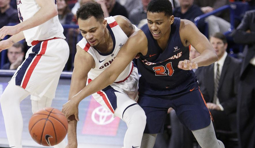 Gonzaga guard Geno Crandall, left, and Pepperdine guard Eric Cooper Jr. go after the ball during the second half of an NCAA college basketball game in Spokane, Wash., Thursday, Feb. 21, 2019. (AP Photo/Young Kwak)