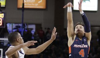 Pepperdine guard Colbey Ross (4) shoots over Gonzaga guard Zach Norvell Jr. during the first half of an NCAA college basketball game in Spokane, Wash., Thursday, Feb. 21, 2019. (AP Photo/Young Kwak)