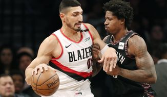 Portland Trail Blazers center Enes Kanter (00) works against Brooklyn Nets forward Ed Davis (17) during the first half of an NBA basketball game Thursday, Feb. 21, 2019, in New York. (AP Photo/Kathy Willens)